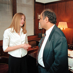 Katie Johnson discusses matters with the Cypriot ambassador to the United Nations, Soto Zackheos. Don Hamerman