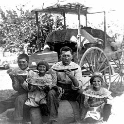 The John W. Mathews family (left) stop for a rest on their two-week trek via horse-drawn 'hack' from their homestead near Buhl, Idaho, to their permanent home in Pullman. It was the summer of 1910. Pictured from the left are Homer Hamilton Mathews, 14; Charlotte, 7; Catherine's father, John Wilbur Mathews; and 9-year-old Catherine. Her mother, Serena Wallis Mathews, took the photo, developed the negative, and made the print. She learned photography through a course at Washington State College.