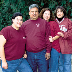 Dad of the Year Daniel Mendez with daughters Veronica (left) and Jennifer and wife, Tina. By Shaun Hudson