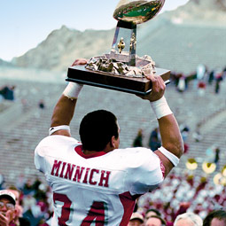 Running back Dave Minnich displays WSU's Sun Bowl trophy. Steve Hanks