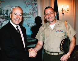 Lt. Col. Kurt Stinemetz (right) greets Jim Ellard, chairman of the Royal Marines Association in London.