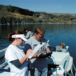Catherine Albaugh and Steve Wakefield, a student at Central Washington University record data, including pH, temperature, dissolved oxygen, salinity, and conductivity, at Soap Lake.