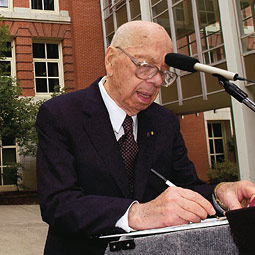 Philip Abelson '33, '35 signed his autograph for a student during the public ceremony September 2002, during which Science Hall on WSU's Pullman campus was renamed Abelson Hall.