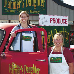 With Marci Schwartz '03 and Trish Scwartz '00 (not shown), Tessa Wicks '96, M.S. '98 (left) and proprietor Kim Roberts '81, '82 (right) run the newly opened Farmer's Daughter, which markets regionally grown food, including flour made from a hard red winter wheat developed by spring wheat breeder Kim Kidwell.