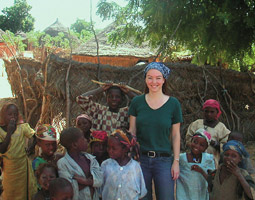 Marissa Lemargie with children in an African village, while serving as political officer for the American Embassy in Niamey, Niger.
