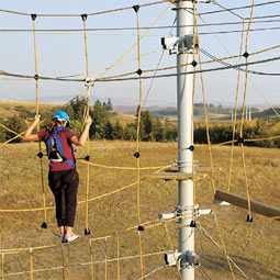 Andrea Blair Cirignano '05 learns to overcome her fears high above the ground in Washington State University's Challenge Course.