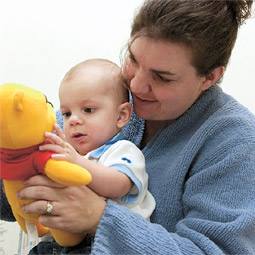 Bringing up baby. Eight-month-old Brandon Hallan and his mother Shyra play with a toy for a WSU study of temperament in infants.