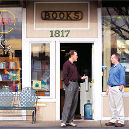 Bookstore owner Clyde Holloway '73 steps out the door of So Many Books to visit with a friend. His Vancouver bookstore like the shops of many other independent booksellers, is a fixture in the community.