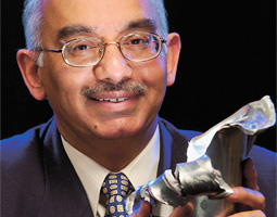 Professor Yogendra Gupta ('72 PhD Phys.), head of the Institute for Shock Physics and recipient of WSU's Eminent Faculty Award, holds the mangled remains of a projectile that was fired through the lab's four-inch gun.