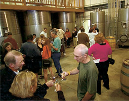 Rick Small '69 (below, right) mingles with guests at Woodward Canyon on spring release weekend in Walla Walla.