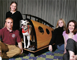 Left to right: Students Josh Schafer '06, Kelly Gordon '07, Whitney Wiggins '06, and Kendra Lundahl '06 designed the winning doghouse for Basil the whippet in a 30-hour design challenge at the WSU Interdisciplinary Design Institute in Spokane.