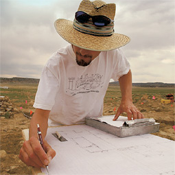 While supervising students, Andrew Duff carefully drafts a site plan for his own use and for future archaeologists who want to learn from the Cox Ranch dig.