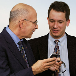 Gregory Belenky, M.D. and Hans Van Dongen of the Sleep Research Institute at WSU Spokane use handheld devices to check the sleep habits and reaction times of their sleep study volunteers.