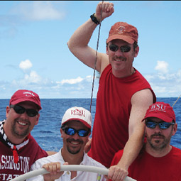 Phil Ohl, Ken Marks, Scott Brown, and John Leitzinger celebrate 'Cougar Day' during the race.