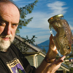 Troll holds a ratfish specimen on the deck of his studio overlooking the Tongass Narrows.