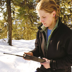 Wildlife biologist Hilary Cooley sets a radio receiver to pick up signals from a collared cougar.