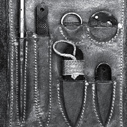 A spy kit of blades and knives.