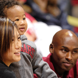 Track and field champion Bernard Lagat '01 with his wife, Gladys Tom '00, and son, Miika, in Pullman last December, when he received a WSU Alumni Achievement award.