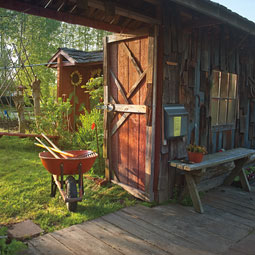 Morning light floods the Master Gardeners demonstration garden in Puyallup. The educational venue is open to the public looking for landscaping ideas or needing help with a gardening problem. <em>Zach Mazur</em>