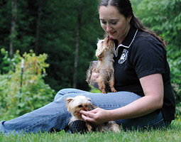 Teresa Steiner '97, president of S.P.O.T., with two of the rescued dogs. <em>Ingrid Barrentine</em>