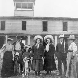 A group pose with a dog in this 1909 photograph of the hotel. <em>Photo courtesy of WSU - MASC.</em>
