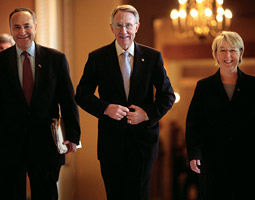 Patty Murray and Senator Charles Schumer (D-NY) escort the newly elected Senate Majority Leader Harry Reid (D-Nev.) in November 2006. <em>Melina Mara/The Washington Post.</em>