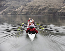 Women's crew team rowing on the Snake River.
