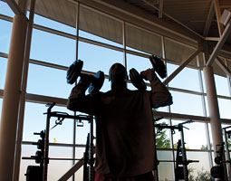 A student-athlete in the renovated weight room. <em>By Robert Hubner</em>
