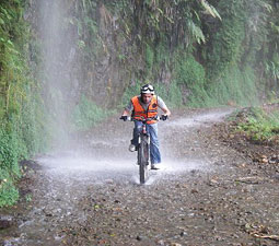 Water pours off the mountain onto bicyclists. Photo courtesy Derren Patterson.