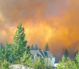 Wildfire burns near a Dishman Hills residence during the 2008 Valley View blaze. <em>Tom Watson/Courtesy Spokane County Conservation District.</em>
