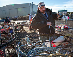 Brian Toste prepares a crab trap for the winter Dungeness season. <em>Bill Wagner</em>