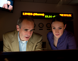 WSU finance professor Rick Sias and finance student Stacee Wilson in the Cougar Investment Fund trading room in Todd Hall. Photo by Robert Hubner