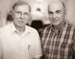 Jay Wright (left) and Joe Harding have discovered that drugs they work with will restore neural connectivity destroyed by dementia in animal models. <em>Robert Hubner</em>