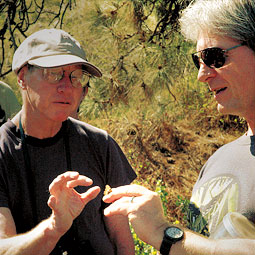 David James (right) tries to convince a Cowiche Canyon visitor that butterflies are not quite as delicate as they look.  <em>Staff photo</em>
