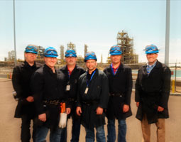 Kirt Johnson &rsquo;94, &rsquo;96, Jason Michelbook &rsquo;99, Colin Connacher &rsquo;90, Curtis Robillard&rsquo;89, Jeff Johnson &rsquo;92, &rsquo;94, and Ron Reis &rsquo;80 at the Renewable Energy Corporation silicon plant in Moses Lake. <em>Robert Hubner</em>