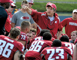 Mike Leach instructing players at spring practice in 2012. <em>Dan Pelle/The Spokesman-Review</em>
