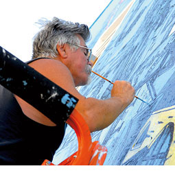 Patrick Siler &rsquo;61 paints his downtown Pullman mural. <em>Zach Mazur/WSU Museum Of Art</em>