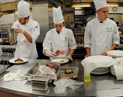WSU students prepare a Feast of the Arts dinner in the College of Business&rsquo;s commercial kitchen. <em>Zach Mazur</em>