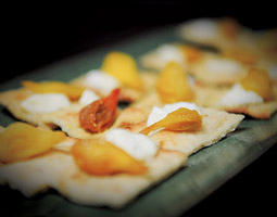 An appetizer from the meal featuring house-made grilled flatbread with fresh goat cheese and roasted teardrop tomatoes. <em>Zach Mazur</em>