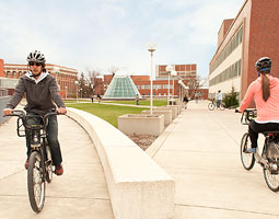 Bryan McLaughlin '11 (at left), Carrie Nevue '12, and senior Nathan Richardson ride BIXI green bikes on campus. WSU is the first university partner for the worldwide bike sharing program. <em>Robert Hubner</em>
