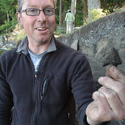 Archaeologist Colin Grier with a newly uncovered Marpole point. <em>Staff photo</em>