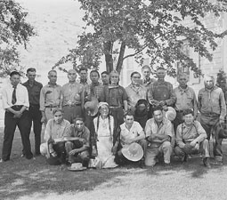 The 1941 photograph features the early members of the Colville Business Council and some of the hereditary chiefs. Peter Gunn is in the first row, second from the right. Chief Jim James is in the center of the second row with a bandana around his neck and braids.