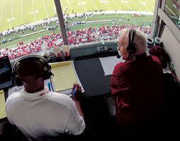 Alongside broadcast partner Shawn McWashington '97, '02 (left), Bob Robertson calls the WSU-Colorado Homecoming game at Martin Stadium, September 22, 2012. <em>Robert Hubner</em>