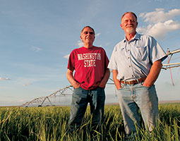 Orman Johnson '69 (left) and brother Gavin, who farm near Othello, irrigate from deep wells. Photo Zach Mazur
