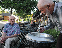 Walt Butcher and Norm Whittlesey get a drink at the Pine Street Plaza fountain in Pullman. Photo Zach Mazur