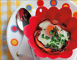 Baked egg in a ham cup. by Monica Bennett