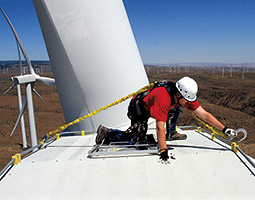 Twenty-three stories up, Dan Rottler clips his safety harness atop a turbine at Puget Sound Energy&#8217;s Wild Horse Wind and Solar Facility. <em>Photo Alan Berner/The Seattle Times</em>