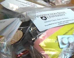 Influenza kits were immediately distributed during the 2009 WSU H1N1 outbreak, and free vaccinations offered. Video frame courtesy King-TV