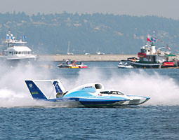 Chip Hanauer piloting the Boeing U-787 biofueled hydroplane at Seafair in 2009. <em>Photo Jason Fortenbacher</em>