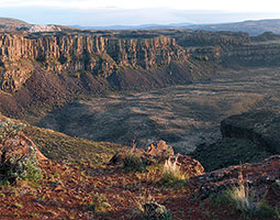 Basalt walls of Frenchman Coulee across the Columbia River at Vantage. <em>Photo Bruce Bjornstad</em>